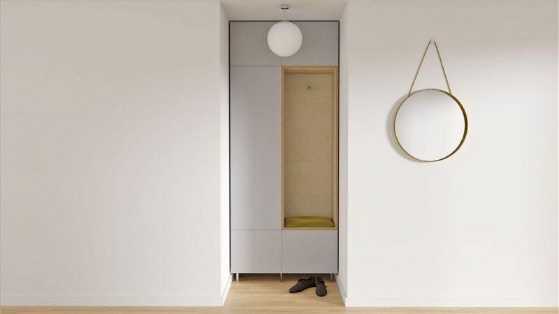 Garderoben-Schrank und Metall-Spiegel rund